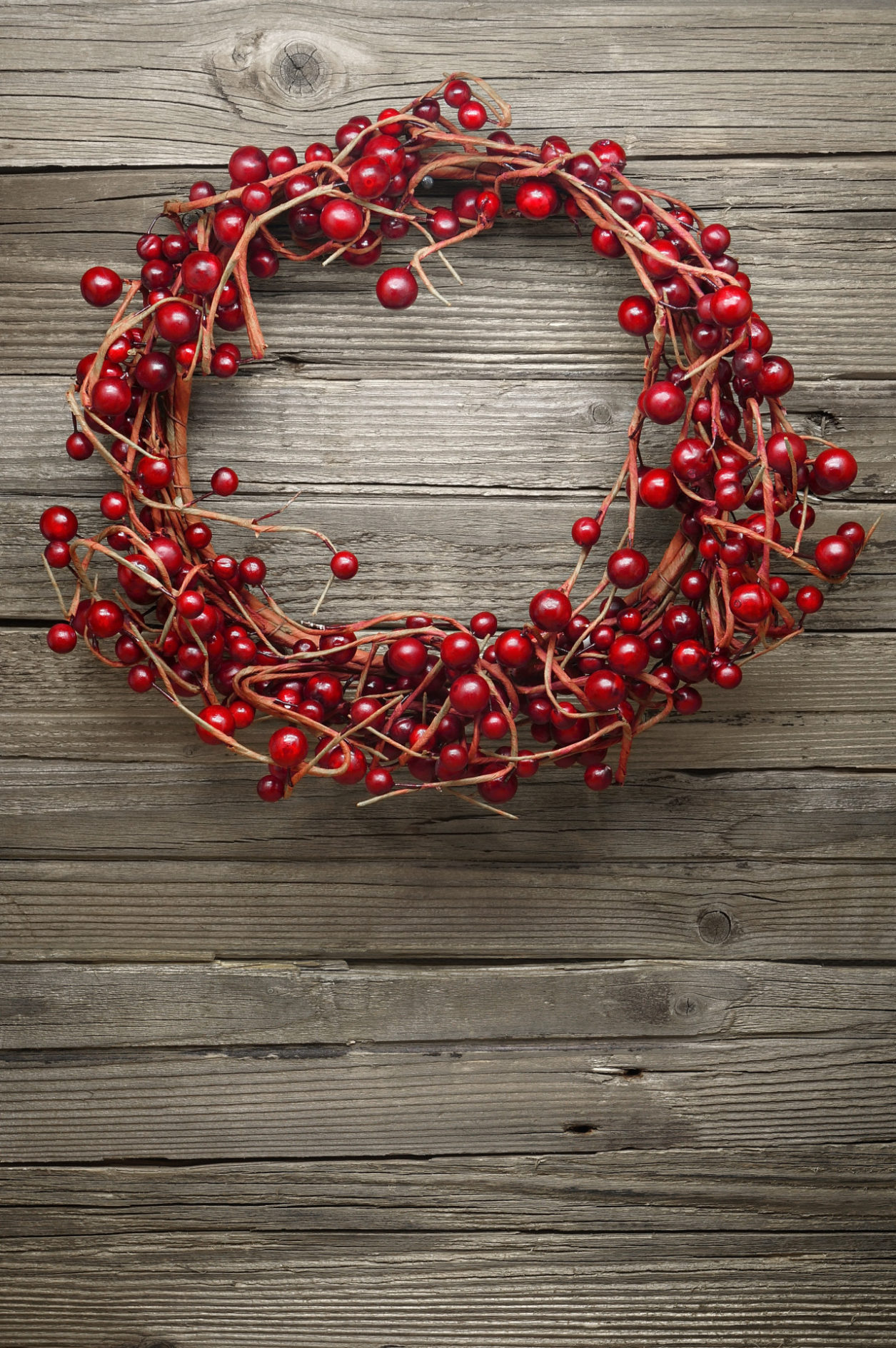 Winterberry Wreath on a Wooden Rustic Background